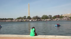 Washington Monument girl across water cherry blossom HD Stock Footage