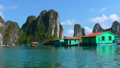 Floating fishing village in Halong Bay Stock Footage