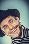 Happy man with half shaved face beard hair in hat. - stock photo