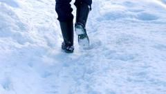 Person Walks On Path In The Snow Stock Footage