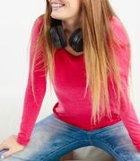 Lady keep headphone on neck. - stock photo