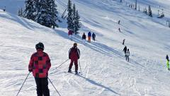 Many People Skiing Down Slope Stock Footage