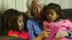 Children showing grandmother something on the tablet pc Stock Footage