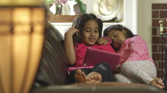 Sisters looking at a tablet pc Stock Footage