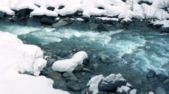 Icy Blue Mountain River In The Snow Stock Footage
