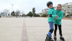 Young skaters skating to  camera Stock Footage