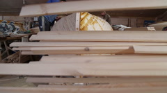 Carpenter blurs resin the spatula the seams of wooden boats - stock footage