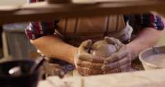 Potter working with clay on a spinning wheel. - stock footage