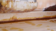 Carpenter blurs resin the spatula the seams of wooden boats Stock Footage