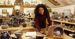 Portrait of a young entrepreneur working in his ceramics store. Slow motion. Stock Footage