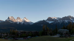 4K Time lapse zoom out 3 Sisters Mountains sunset Canmore Stock Footage