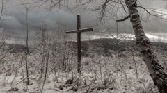 Cross in The Mountains in Winter. time lapse. The Sun Shines through the - stock footage