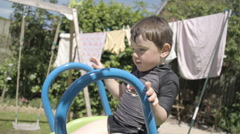 Little Boy Playing In The Back Garden On Summers Day - stock footage