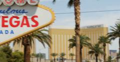 4K- Panning shot from Las Vegas strip palm trees to Welcome to Fabulous sign - stock footage