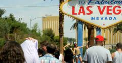 4K people tourists in line at the Welcome to Fabulous Las Vegas sign Stock Footage