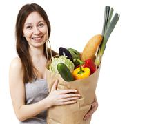 Young Woman Holding Large Bag of Healthly Groceries - Stock Imag Stock Photos