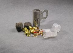 set of percussion caps and felt wad for reloading - stock photo