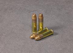 .22 caliber hollow point   Long rifle Rimfire Ammunition on canvas - stock photo