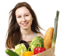 Young Woman Holding Large Bag of Healthly Groceries - Stock Imag - stock photo