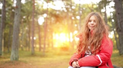 Smiling little girl in red jacket in autumn park Stock Footage