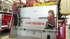 Little Boys Playing On Fire Truck Stock Footage