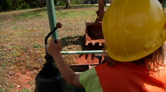 Little Boy Playing On Construction Equipment Stock Footage