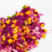 salad of red cabbage, onion, yellow corn and apple - stock photo