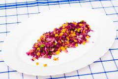 Salad of red cabbage, onion, yellow corn and apple Stock Photos