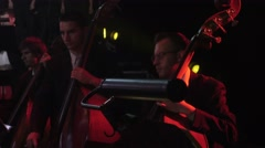 Contrabass Section of an Orchestra Rock Symphony Musicians Are Playing Double - stock footage