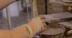 Ceramist attaching a handle to a mug Stock Footage