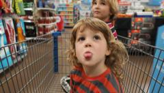 Boys Riding In Shopping Cart Time Lapse - stock footage