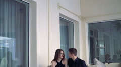 Sexy couple sitting at the luxurious balcony and caressing one by one. - stock footage