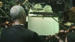 Violinists In an Orchestra Are Performing Music Hits The Greatest Hits by Rock Stock Footage
