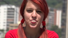 Teen Redheaded Female Blowing Bubblegum Stock Footage