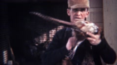 1939: Hunting man wears dead pheasant birds necklace. Stock Footage