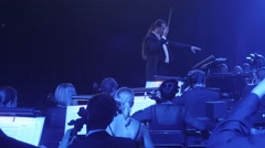 Rock Symphony a Man is Conducting Orchestra Cello and Double Bass Group - stock footage