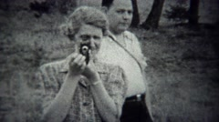 1939: Photographers pointing film cameras at cinematographer. Stock Footage