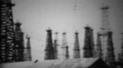1938: California oil drilling fields steel derrick tower rigging. Stock Footage