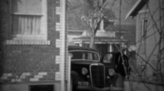 1936: Couple exits Lincoln car enters suburban brick home. Stock Footage