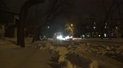 Tram rides on a snow-covered street, is a fine snow, night Stock Footage