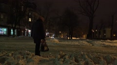 Snow-covered city street with night lights, is fine snow, in bad stormy weather Stock Footage
