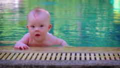 Cute Baby Boy in a Swimming Pool. UltraHD video Arkistovideo