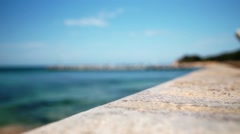Beach with clear blue water with Foreground in focus - stock footage