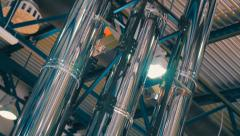 Shiny chrome ventilation pipes in a large hangar Stock Footage