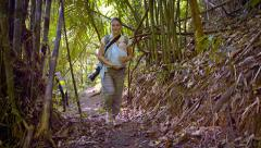Tourist Hiking in Tropical Wilderness with Baby, with Sound Stock Footage