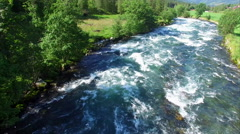 Flying above fast river in Norway Stock Footage