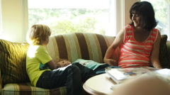 Mother With Children Waiting In Doctors Office - stock footage