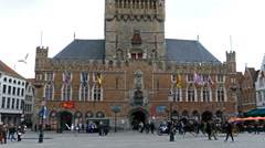 Horse-drawn carriage with tourists in Grote Markt, Brugge, Belgium Stock Footage