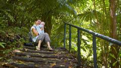 Hiker Pauses to Rest with her Baby on a Nature Trail Stock Footage