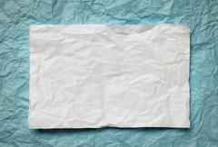 paper card on cyan background - stock photo